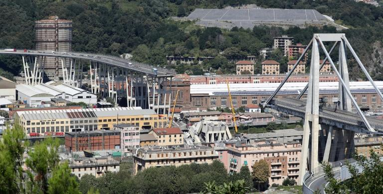 Abandoned vehicles on the Morandi motorway bridge which collapsed in the north-western Italian city of Genoa, claiming at least 39 lives