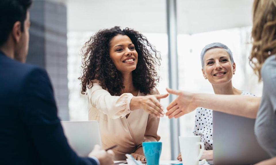 Businesswomen shaking hands at the office