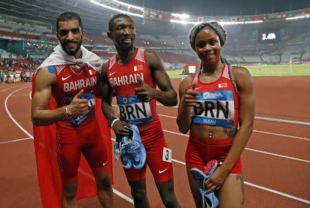 Athletics - 2018 Asian Games - Mixed 4x400m Relay, Final - GBK Main Stadium, Jakarta, Indonesia - August 28, 2018 - Ali Khamis, Salwa Naser and Abbas Abbas of Bahrain celebrate winning. REUTERS/Issei Kato