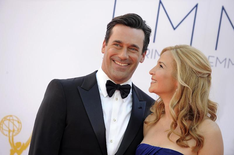 Jon Hamm, left and Jennifer Westfeldt arrive at the 64th Primetime Emmy Awards at the Nokia Theatre on Sunday, Sept. 23, 2012, in Los Angeles.  (Photo by Jordan Strauss/Invision/AP)