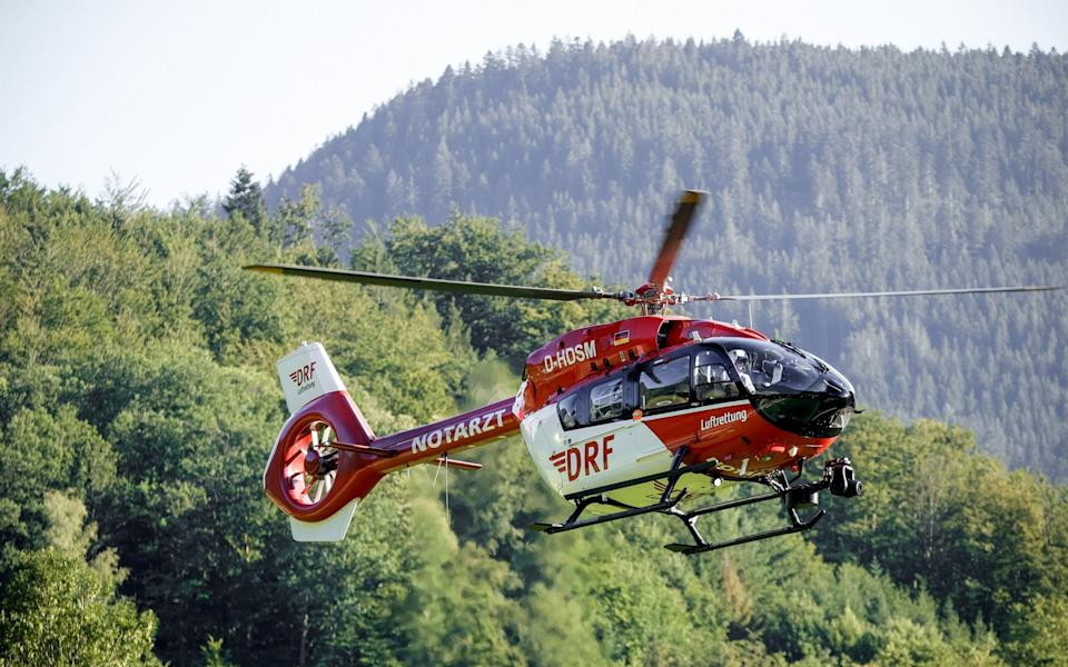 A DRF helicopter with German police officers is searching for a man armed with knives and pistols in a forest area north of Oppenau near Offenburg -  RONALD WITTEK/EPA-EFE/Shutterstock/Shutterstock