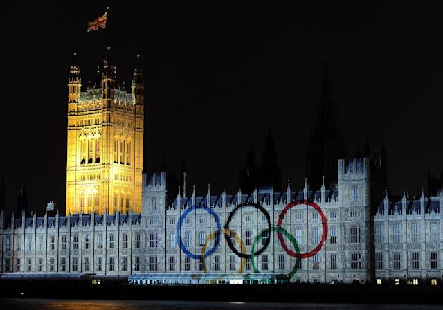 LONDON, ENGLAND - JULY 27: The Olympic rings are projected onto the House of Parliament during a light show to mark the start of the 2012 Olympic Games on July 27, 2012 in London, England. (Photo by Harry How/Getty Images)