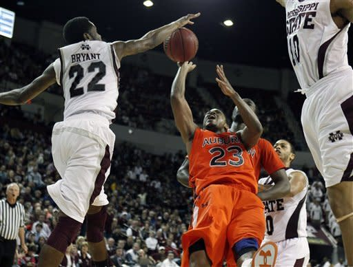 Auburn guard Frankie Sullivan (23) has his shot blocked by Mississippi State guard Brian Bryant (22) in the second half of an NCAA college basketball game in Starkville, Miss., Saturday, Feb. 4, 2012. Mississippi State won 91-88. (AP Photo/Rogelio V. Solis)
