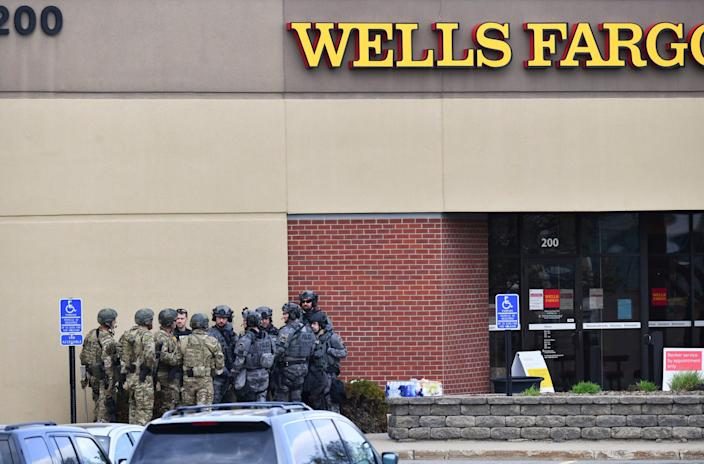 <p>Law enforcement officers gather near the entrance of a Wells Fargo Bank branch Thursday, 6 May 2021, in St Cloud, Minnesota</p> (Associated Press)
