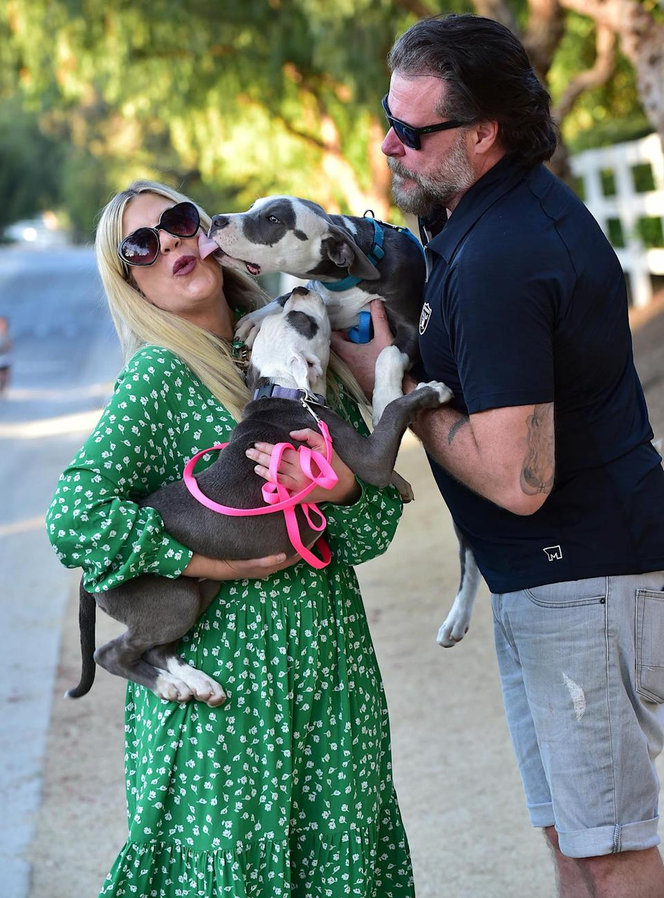 <p>Tori Spelling gets sweet kisses from her dogs while out for a walk with husband Dean McDermott on Monday in L.A.</p>