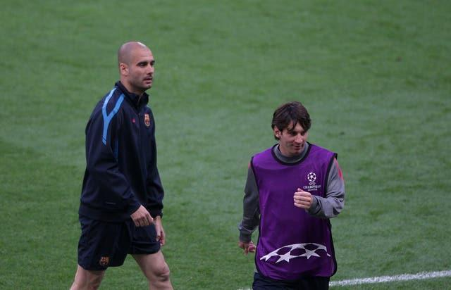 Former Barcelona manager Pep Guardiola (left) and Lionel Messi in training