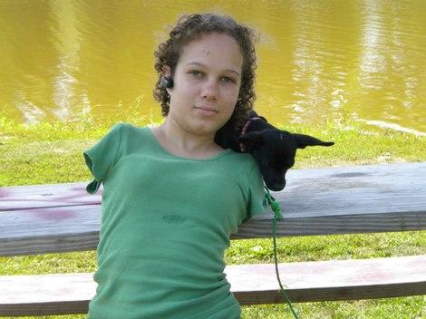 Tisha UnArmed (with her dog, Jack) took to YouTube to show people how she navigates life without her arms.