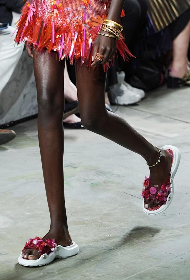<p>Slides are a staple in many a woman's wardrobe, but for Spring 2020, the 2.0 version is reincarnated by way of fun embellishments, unexpected textures, and chunky soles. If you're routinely conflicted between style and comfort, this trend is your happy medium. </p> <p>Versace Shoes on the Runway at Milan Fashion Week</p>