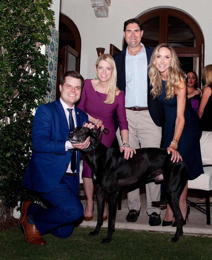 U.S. Rep. Matt Gaetz, Pam Bondi, Blair Brandt, and Lara Trump pose with Bart, a racing greyhound saved from being euthanized after he broke his leg. The reception was a fundraiser to support the Humane Society's efforts to find homes for greyhounds at home in Palm Beach Friday, Feb. 8,  2019.
