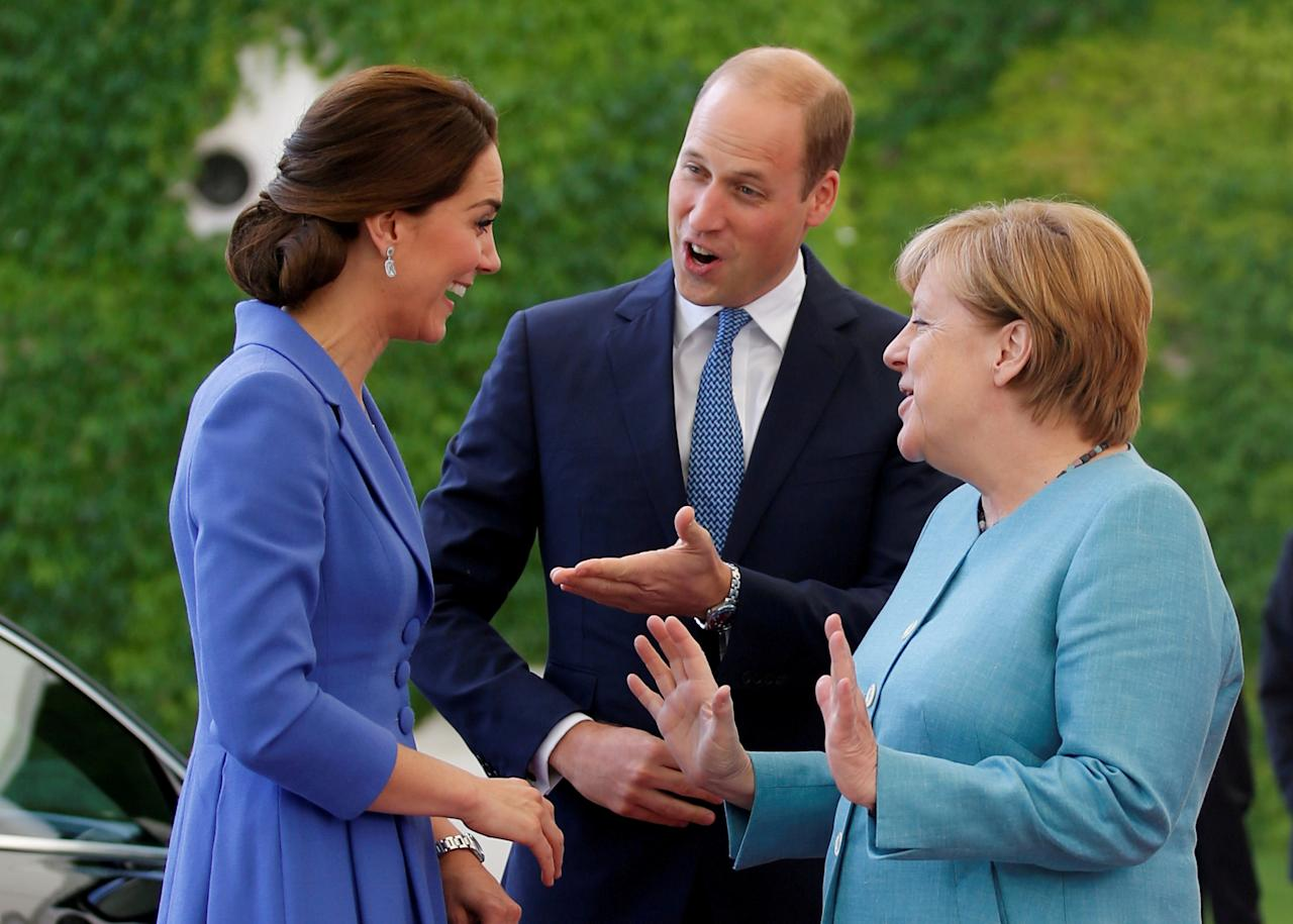 FILE PHOTO: German Chancellor Angela Merkel chats with Prince William, the Duke of Cambridge and his wife Catherine, The Duchess of Cambridge, at the Chancellery in Berlin, Germany July 19, 2017. REUTERS/Axel Schmidt/File Photo