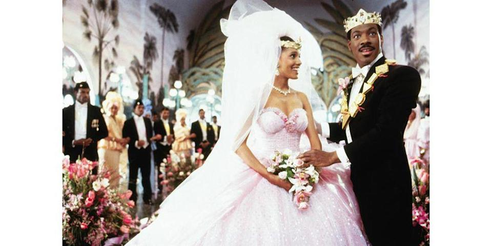 <p>What to wear when you suddenly become a princess? Lisa McDowell, played by Shari Headley, nailed her wedding dress to Prince Akeem with a light pink strapless tulle ball gown and gold crown for the ceremony. </p>