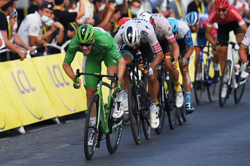 Sam Bennett opens up his sprint on the Champs Elysees in Paris