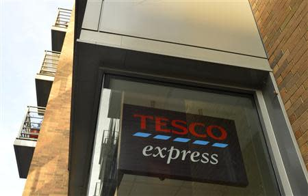 A Tesco logo is seen on a branch of the Tesco Express convenience store below a residential building in central London December 12, 2013. REUTERS/Toby Melville
