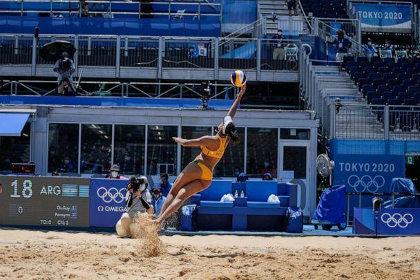 PHOTO: Eduarda Santos Lisboa, of Brazil, reaches for the ball during a women's beach volleyball match against Argentina at the 2020 Summer Olympics, Saturday, July 24, 2021, in Tokyo, Japan. (Petros Giannakouris/AP Photo)