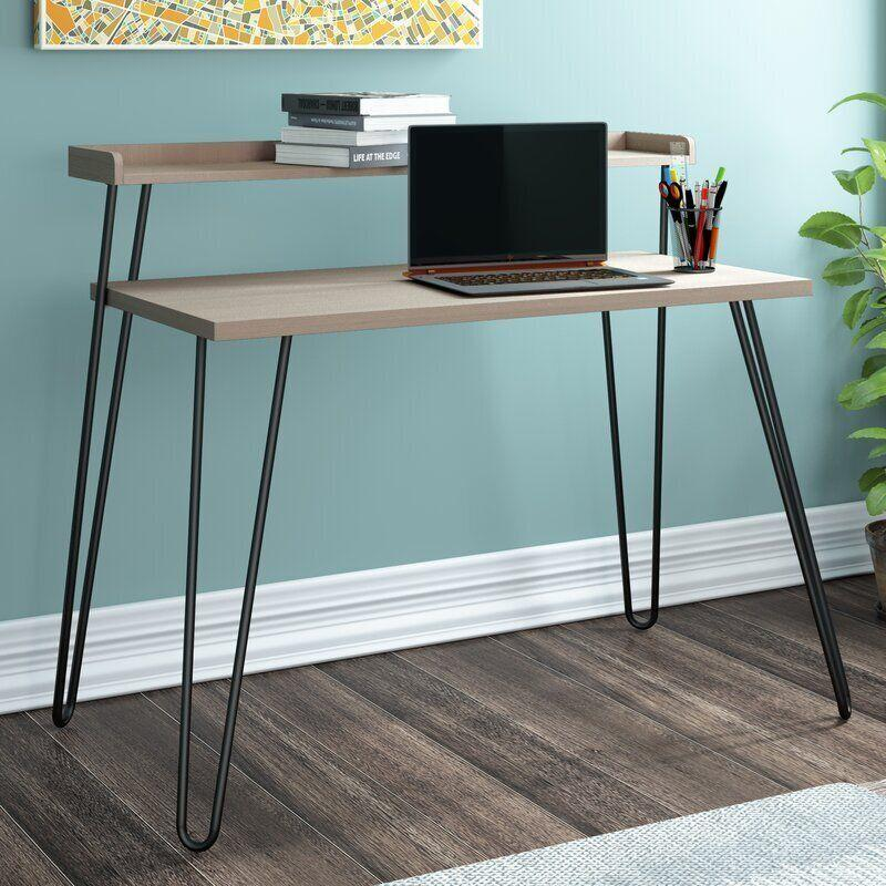 "This desk mixes industrial and modern styles into one design. You get two levels of desk space, so you can work from your laptop while keeping your books and files on top. Of course, we can't help but love the hairpin legs. <a href=""https://fave.co/34ZUPHX"" target=""_blank"" rel=""noopener noreferrer"">Originally $139, get it now for $94 at Wayfair</a>."
