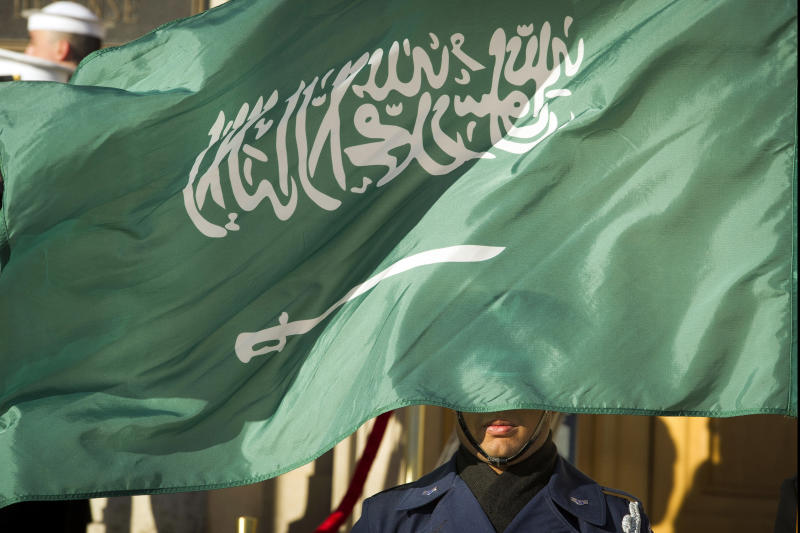 FILE - In this March 22, 2018 file photo, an Honor Guard member is covered by the flag of Saudi Arabia as Defense Secretary Jim Mattis welcomes Saudi Crown Prince Mohammed bin Salman to the Pentagon with an Honor Cordon, in Washington Saudi Arabia's Interior Ministry said Tuesday, April 23, 2019, that 37 Saudi citizens have been beheaded in a mass execution that took place across various regions of the country. Saudi King Salman ratified the executions for terrorism-related crimes by royal decree. (AP Photo/Cliff Owen, File)