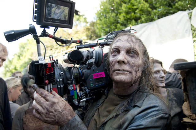 "<p><em>TWD</em> director, EP, and makeup whiz Greg Nicotero takes on another role — walker — for the Dumpster scene in ""Thank You.""<br><br>(Photo: AMC) </p>"