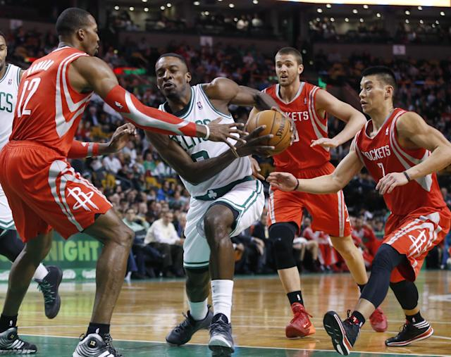 Boston Celtics forward Jeff Green (8) drives against Houston Rockets forwards Dwight Howard (12), Chandler Parsons and guard Jeremy Lin (7) in the first half of an NBA basketball game in Boston, Monday, Jan. 13, 2014. (AP Photo/Elise Amendola)