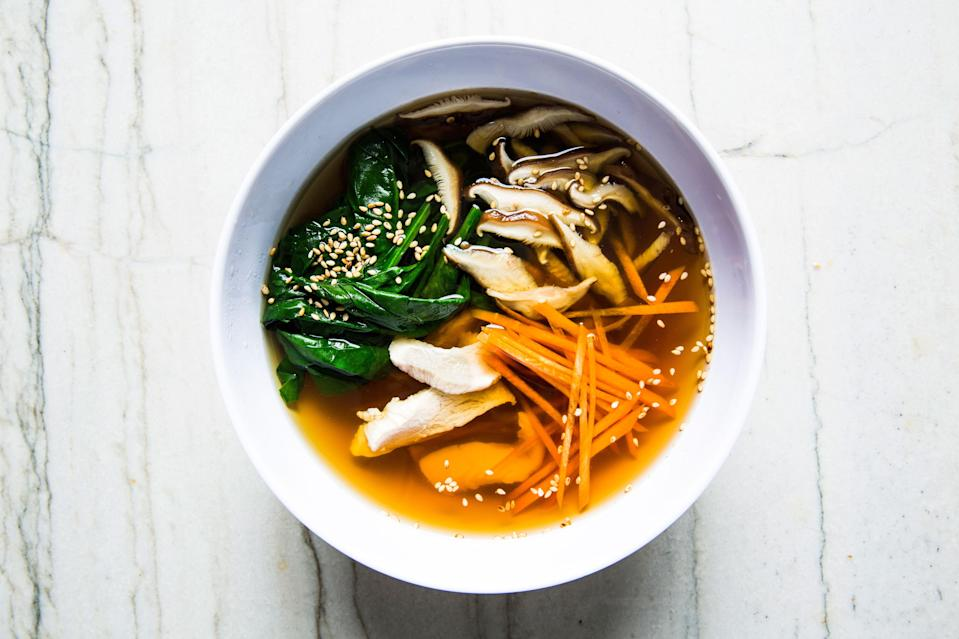 "This minimal and restorative soup recipe is based on dashi, the essential Japanese stock that is the base of miso soup and other dishes. We think it's most delicious when made with homemade chicken stock. <a href=""https://www.bonappetit.com/recipe/kombu-chicken-soup-with-carrots-and-mushrooms?mbid=synd_yahoo_rss"" rel=""nofollow noopener"" target=""_blank"" data-ylk=""slk:See recipe."" class=""link rapid-noclick-resp"">See recipe.</a>"