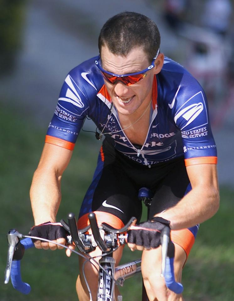 """FILE - This June 26, 2001, file photo shows Lance Armstrong fighting his way up the hill in Crans-Montana, Switzerland, during the 8th stage mountain time trial of the Tour de Suisse. The director of the Swiss anti-doping laboratory informed federal authorities last fall that Armstrong's test results from the 2001 Tour de Suisse were """"suspicious"""" and """"consistent with EPO use,"""" The Associated Press has learned. Martial Saugy made the statement in September, according to a person familiar with the investigation, who spoke on condition of anonymity because he was not authorized to speak publicly about the case."""