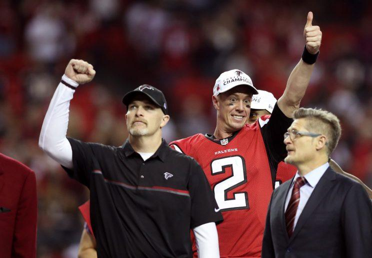 Dan Quinn, Matt Ryan, and Thomas Dimitroff celebrate the NFC championship, the last good game the Falcons played. (Getty)