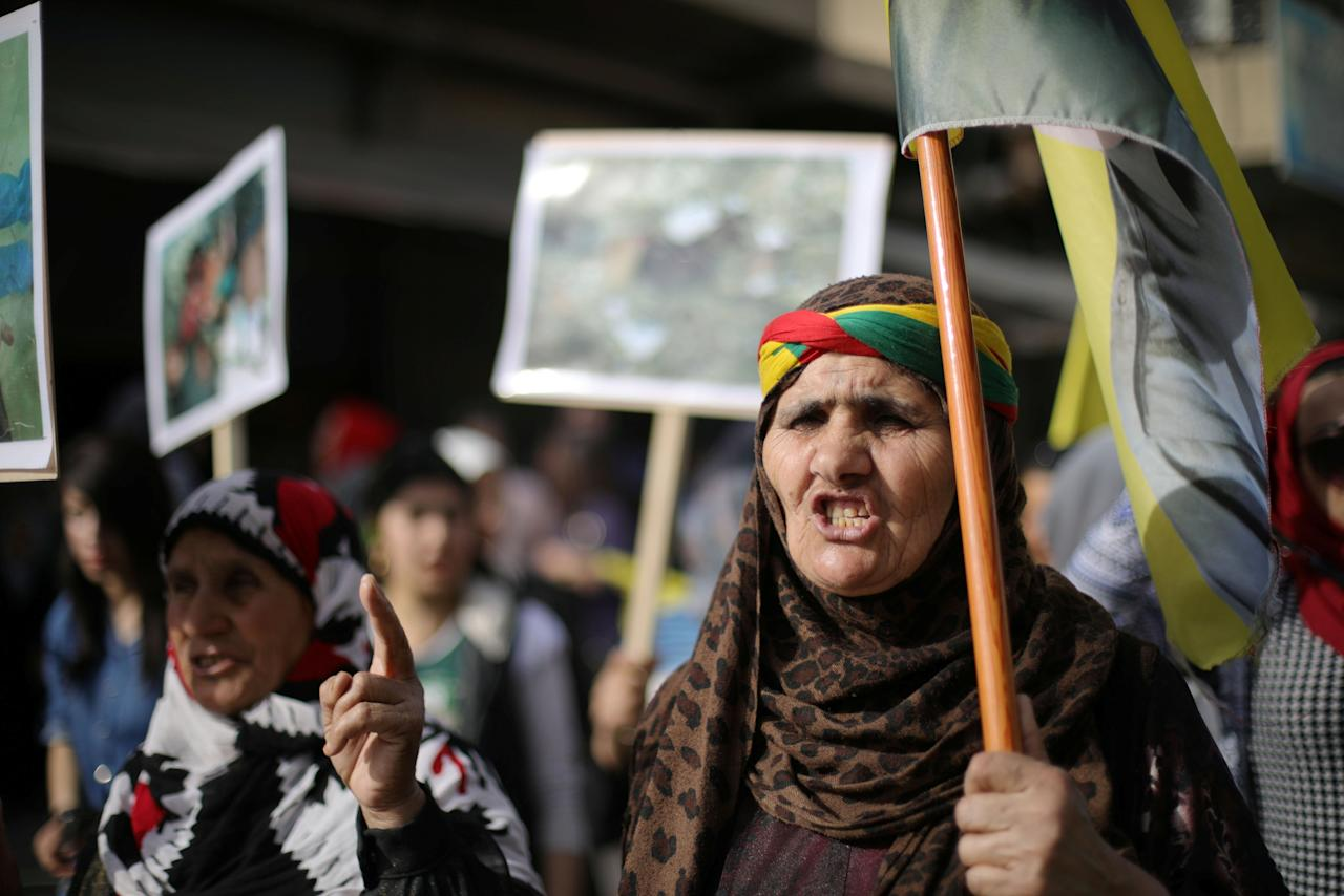 A Kurdish demonstrator protests against the deployment of Turkish forces in Afrin, in Qamishli, Syria March 18, 2018. REUTERS/Rodi Said