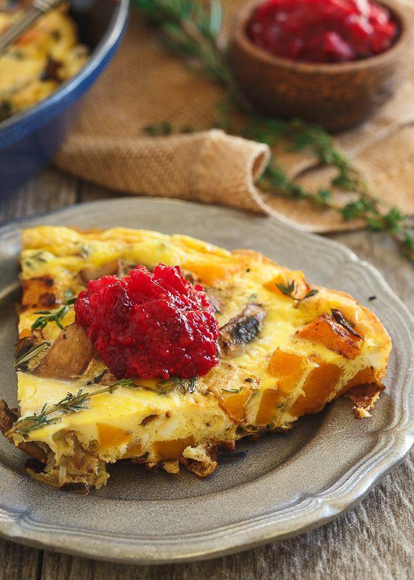 """<p>Finish off this mushroom- and butternut squash-stuffed egg bake with a dollop of <a href=""""https://www.countryliving.com/food-drinks/g4951/best-homemade-cranberry-sauce-recipes/"""" rel=""""nofollow noopener"""" target=""""_blank"""" data-ylk=""""slk:cranberry sauce"""" class=""""link rapid-noclick-resp"""">cranberry sauce</a>.</p><p><strong>Get the recipe at <a href=""""https://www.runningtothekitchen.com/thanksgiving-breakfast-frittata/"""" rel=""""nofollow noopener"""" target=""""_blank"""" data-ylk=""""slk:Running to the Kitchen"""" class=""""link rapid-noclick-resp"""">Running to the Kitchen</a>.</strong></p>"""