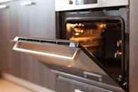 """You don't need to use noxious cleaners and high heat to get your oven clean. <strong>Stan Atanasov</strong>, a home cleaning expert at <a href=""""https://www.paulscleaningmelbourne.com.au/"""" rel=""""nofollow noopener"""" target=""""_blank"""" data-ylk=""""slk:Paul's Cleaning Melbourne"""" class=""""link rapid-noclick-resp"""">Paul's Cleaning Melbourne</a>, recommends making a paste of baking soda and water and spreading it across the interior of your <a href=""""https://bestlifeonline.com/oven-cleaning-tips/?utm_source=yahoo-news&utm_medium=feed&utm_campaign=yahoo-feed"""" rel=""""nofollow noopener"""" target=""""_blank"""" data-ylk=""""slk:oven"""" class=""""link rapid-noclick-resp"""">oven</a>, then letting it sit for 30 minutes. You can then wipe away the paste—and the gunk beneath it—with a damp cloth. Anything left over can be easily removed with a bit of white vinegar in a spray bottle."""