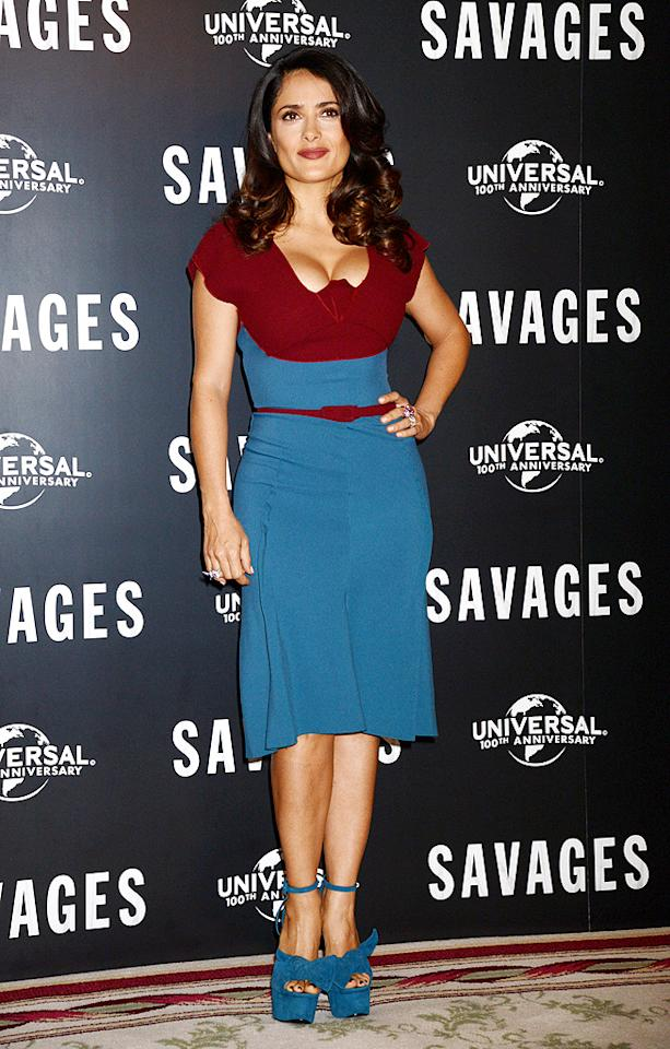 "Pene's fashionable gal pal, Salma Hayek, also impressed us this week. Attending a press event for <a target=""_blank"" href=""http://movies.yahoo.com/movie/savages-2012/"">""Savages""</a> at the Mandarin Oriental Hotel in London, the Mexican beauty flaunted her curves in a color-blocked Roland Mouret ""Mercy"" dress and bow-adorned Giuseppe Zanotti platform heels. (9/19/2012)<br><br><a target=""_blank"" href=""http://twitter.com/YahooOmg"">Follow omg! on Twitter!</a>"
