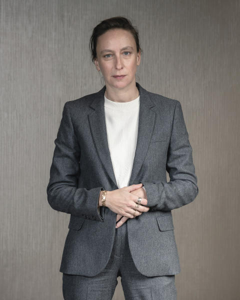 """FILE - This Sept. 30, 2019, file photo shows filmmaker Celine Sciamma posing for a portrait in New York to promote her film, """"Portrait of a Lady on Fire."""" The emotions stirred up by the film have been considerable since its debut at last May's Cannes Film Festival. There, it won best screenplay and Sciamma became the first female director to win the Queer Palme, an award given to the best LGBTQ-themed film across the festival. (Photo by Christopher Smith/Invision/AP, File)"""