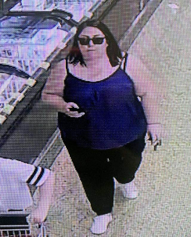 The suspect is a dark-haired woman wearing sunglasses and a sleeveless blue top. (Picture: SWNS)