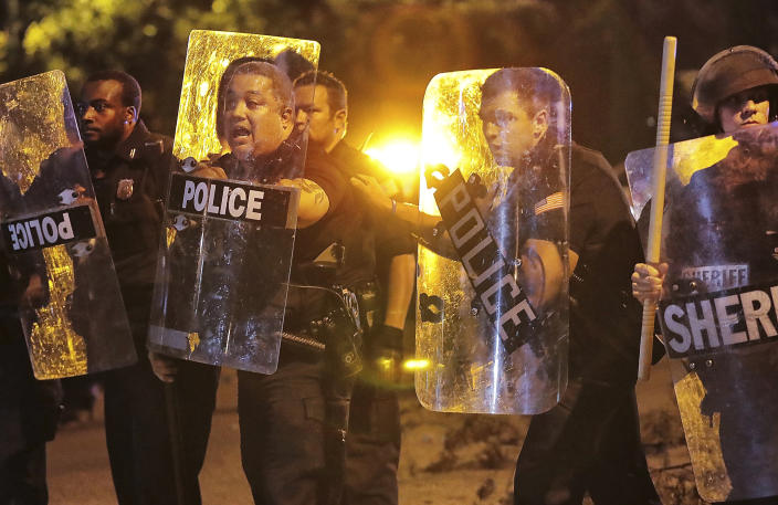 Memphis police brace against the crowd as protesters take to the streets of the Frayser community in anger against the shooting a youth by U.S. Marshals earlier in the evening, Wednesday, June 12, 2019, in Memphis, Tenn. (Photo: Jim Weber/Daily Memphian via AP)