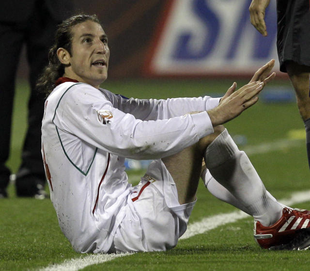 FILE - In this Jan. 22, 2011, file photo, Iran's player Anderanik Teymourian complains to referees during his AFC Asian Cup Quarter Finals soccer match against South Korea at Qatar Sports Club Stadium, in Doha, Qatar. (AP Photo/Kin Cheung, File)