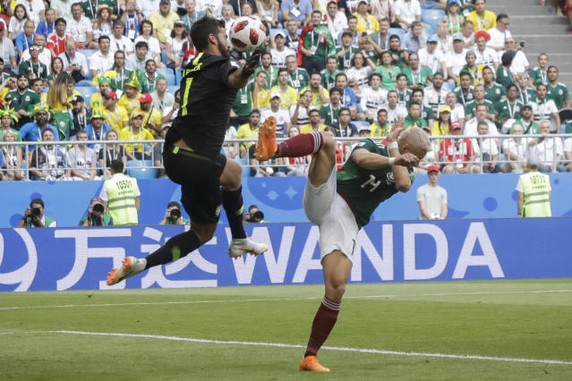 <p>Brazil goalkeeper Alisson, left, blocks a kick by Mexico's Javier Hernandez, right, during the round of 16 match between Brazil and Mexico at the 2018 soccer World Cup in the Samara Arena, in Samara, Russia, Monday, July 2, 2018. (AP Photo/Andre Penner) </p>