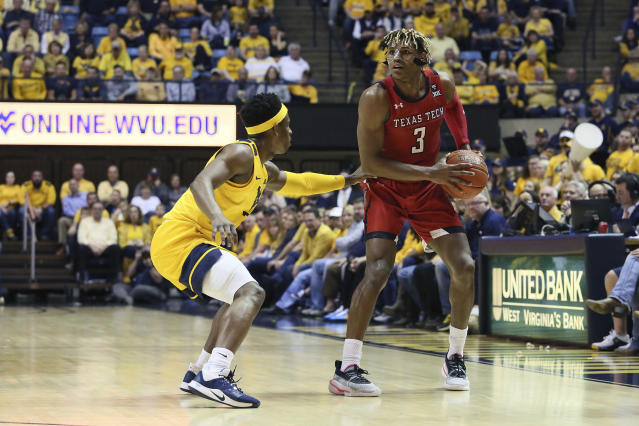 Texas Tech guard Jahmi'us Ramsey (3) drives upcourt as he is defended by West Virginia guard Brandon Knapper, left, during the first half of an NCAA college basketball game Saturday, Jan. 11, 2020, in Morgantown, W.Va. (AP Photo/Kathleen Batten)