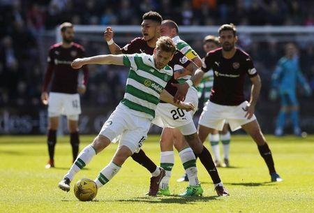 Britain Football Soccer - Heart of Midlothian v Celtic - Scottish Premiership - Tynecastle - 2/4/17 Celtic's Stuart Armstrong in action with Heart's Bjorn Maars Reuters / Russell Cheyne Livepic