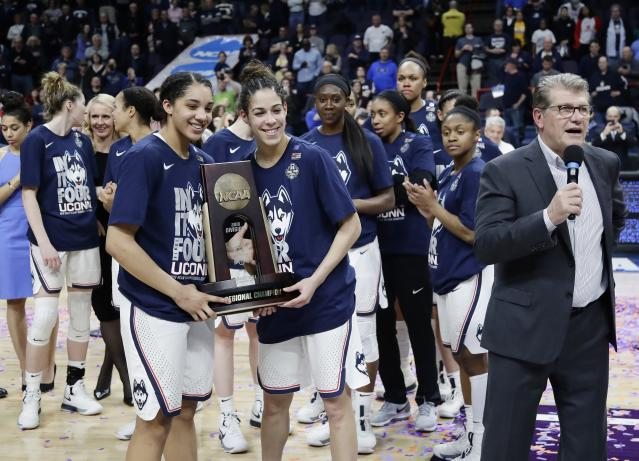 Will Geno Auriemma (right) and the Huskies be hoisting another title on Sunday? (AP)