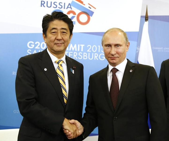 File photo taken on September 5, 2013 show's Russia'n President Vladimir Putin and with Japan'ese Prime Minister Shinzo Abe (L) at the G20 summit in Saint Petersburg