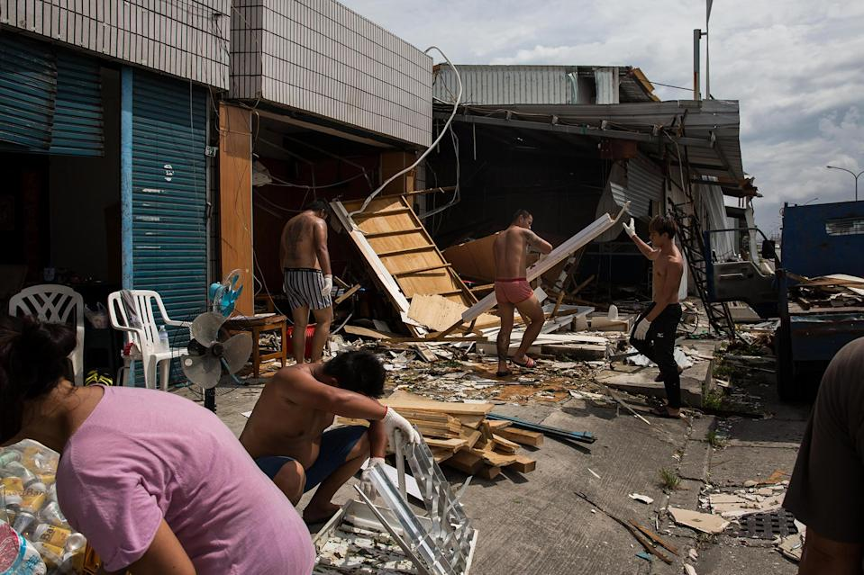 <p>Local residents tidy their houses damaged by Typhoon Nepartak on July 9, 2016 in Taitung, Taiwan. (Photo: Billy H.C. Kwok/Getty Images) </p>