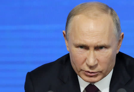 Russian President Putin speaks during annual news conference in Moscow