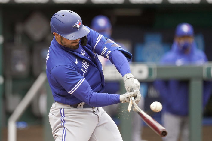 Toronto Blue Jays' Randal Grichuk breaks his bat as he hits for a single during the first inning against the Kansas City Royals in the first baseball game of a doubleheader, Saturday, April 17, 2021, in Kansas City, Mo. (AP Photo/Charlie Riedel)
