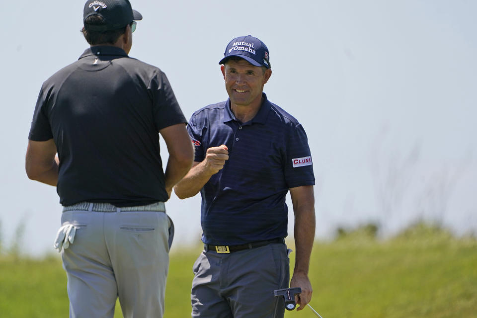 Padraig Harrington, of Ireland, celebrates a birdie along with Phil Mickelson, left, on the sixth hole during the second round of the PGA Championship golf tournament on the Ocean Course Friday, May 21, 2021, in Kiawah Island, S.C. (AP Photo/Chris Carlson)