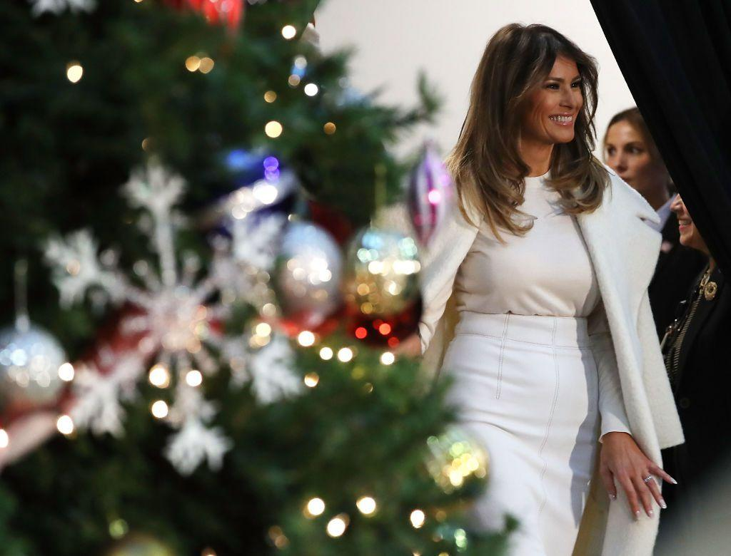 The First Lady arrived at a DC Children's hospital wearing an all-white ensemble, and proving, once again, that she's a big fan of the no-sleeve #fashun coat drape.