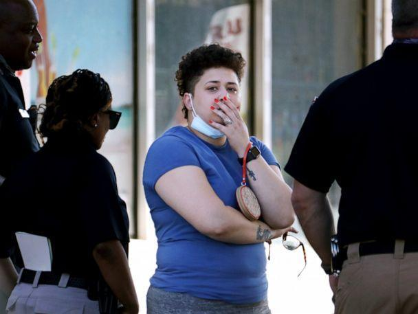 PHOTO: Family members of victims wait with Memphis Police Department officers outside of a post office after a shooting, Oct. 12, 2021, in Memphis, Tenn. (Patrick Lantrip/Daily Memphian via AP)