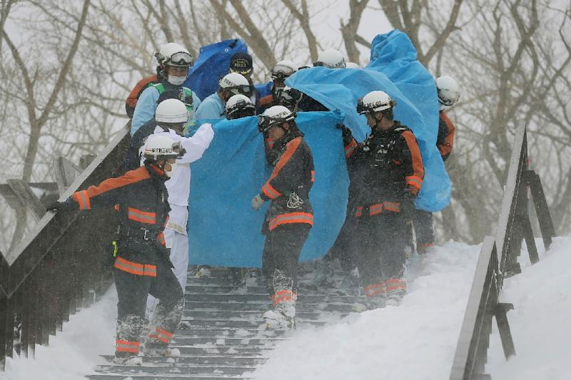 More than 100 troops have been deployed in a massive rescue effort after an avalanche hit Tochigi prefecture in Japan, killing eight students (AFP Photo/JIJI PRESS)