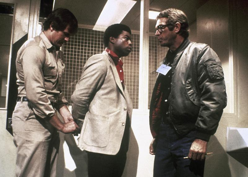 """Actor Steve McQueen, right, shown with actor LeVar Burton, center, in a Paramount film """" The Hunter"""" in which he plays a modern bounty hunter. Man at left is unidentified. (AP Photo/Paramount)"""