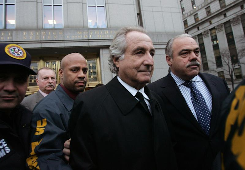 NEW YORK - JANUARY 5: Bernard Madoff (C) walks out from Federal Court after a bail hearing in Manhattan January 5, 2009 in New York City. Madoff is accused of running a $50 billion Ponzi scheme through his investment company. Madoff is free on bail and hasn�t formally responded to the charges or entered a plea. (Photo by Hiroko Masuike/Getty Images)