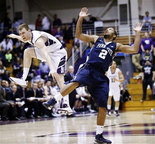 Northwestern guard Alex Marcotullio, left, collides with Penn State guard D.J. Newbill during the first half of an NCAA college basketball game, Thursday, March 7, 2013, in Evanston, Ill. (AP Photo/Charles Rex Arbogast)