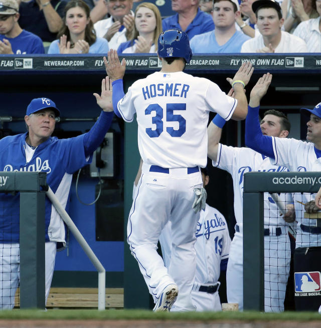 Kansas City Royals' Eric Hosmer (35) celebrates coming into the dugout after scoring on single by teammate Billy Butler during the first inning of a baseball game against the Chicago White Sox on Monday, May 19, 2014, in Kansas City, Mo. (AP Photo/Charlie Riedel)
