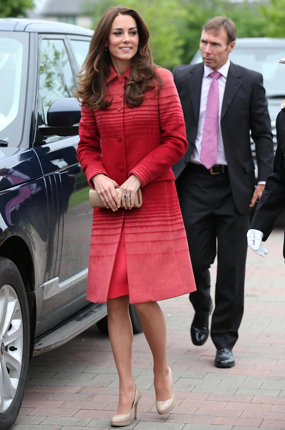 <p>Kate donned a red ombre coat by Jonathan Saunders for a day of engagements in Scotland. She paired the look with two favourites: a nude clutch and heels by L.K. Bennett. </p><p><i>[Photo: PA]</i></p>